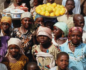 Nigeria,group of children in market girls wearing colourful headscarfs