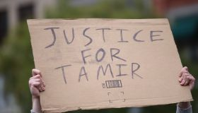 Justice for Tamir sign held aloft. Stop Mass Incarcerations...