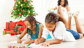 Children Drawing and Coloring to Santa Claus.