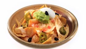 Close-Up Of Nachos In Bowl On White Background