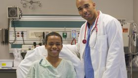 Doctor in hospital room with patient