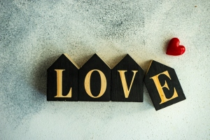 Word LOVE written with wooden blocks and a heart shape decoration